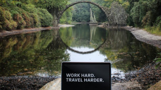 Developer testimonial on how to relax with nature while working remotely. Laptop screen spells Work hard. Travel harder.