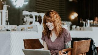 Woman staring at laptop screen