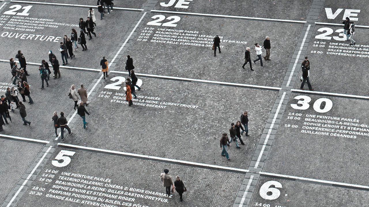 People walking over calendar painted on floor